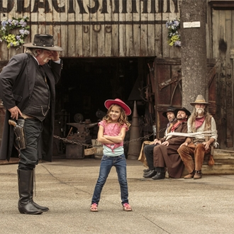 Girl with sheriff and bandits at Knott's Berry Farm in Buena Park, CA