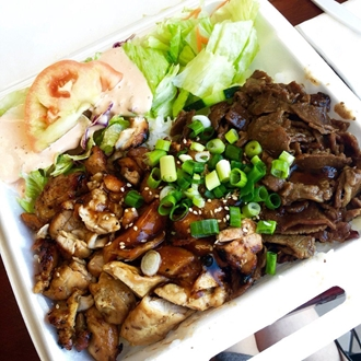 Meat and lettuce on a plate at Golden Bowl in Buena Park