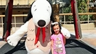 Girl posing with Snoopy at Knotts Berry Farm in Buena Park, CA