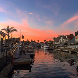 Canal with houses and boats at Huntington Harbor Boat Rentals