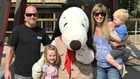 Family with Snoopy at Knotts Berry Farm in Buena Park, CA.