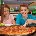Children eating pizza at Johns Incredible Pizza in Buena Park