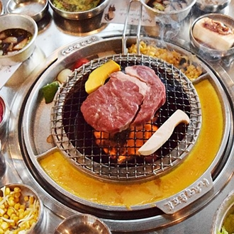 Ribeye on grill at Kang Ho Dong in Buena Park