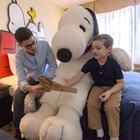 Dad and child reading with Snoppy at Knott's Berry Farm Hotel in Buena Park