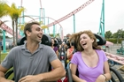 Couple on roller coaster at Knott's Berry Farm in Buena Park, CA