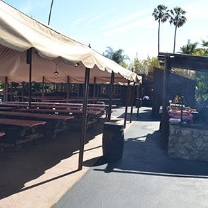 Tables under a canopy at Gold Rush Camp Knott's Berry Farm in Buena Park