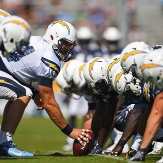 Los Angeles Chargers hiking the football
