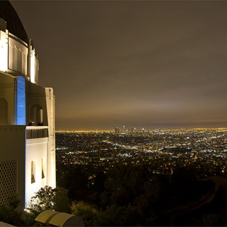 Los Angeles city at night with the Griffith Observatory to the left