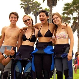 Friends in wet suits at Learn2Rip Surf & Ocean Academy