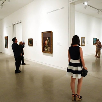 Attendees looking at paintings at Orange County Museum of Art