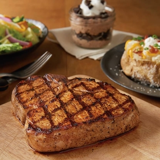 Steak, salad, potato, and desert at Outback Steakhouse in Buena park