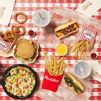 Hamburger, hotdogs, fries, salad, onion rings, and drink at Portillo's in Buena Park