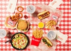 Salad, fries, hot dog, burger, drinks at Portillo's in Buena Park, CA