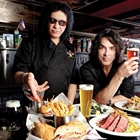 Paul Stanley and Gene Simmons with food and drinks at Rock & Brews in Buena Park