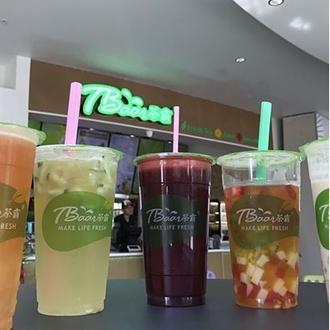 Five teas in plastic cups in front of Tbaar sign at Tbaar in Buena Park