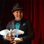 Magician holding bird at Teatro Martini in Buena Park