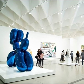 Attendees looking at various art pieces at The Broad