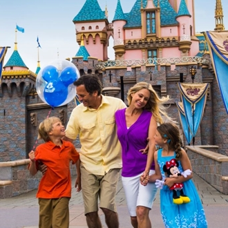 Family in front of Sleeping Beauty Castle at Disneyland