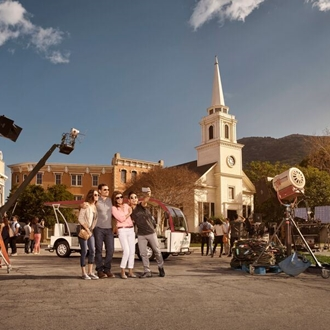 Family taking a photo in front of a movie set at Warner Bros. Studio Tour Hollywood