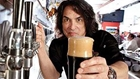 Gene Simmons serving beer at Rock & Brews in Buena Park