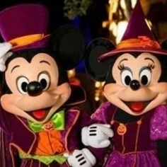 Micky and Minnie Mouse in Halloween clothes at Disneyland
