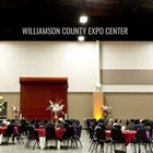Wedding setup with round table and chairs on this northside of the Indoor Expo Hall.