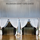 Entrance way into the Indoor Expo Hall wedding reception with white flowing curtans.