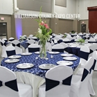 Round tables decorated with white and blue table clothes for a wedding receiption dinner