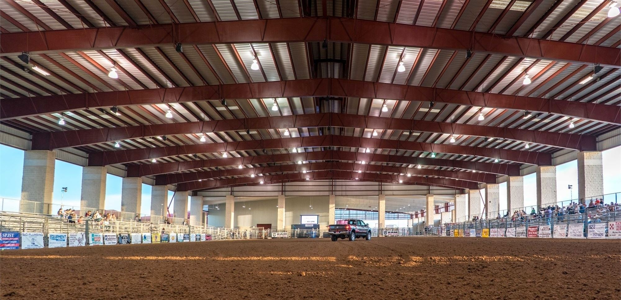 The main arena looking south towards the Main Expo Hall. Black truck in the distance of the arena setting up barrels for the Taylor Rodeo.