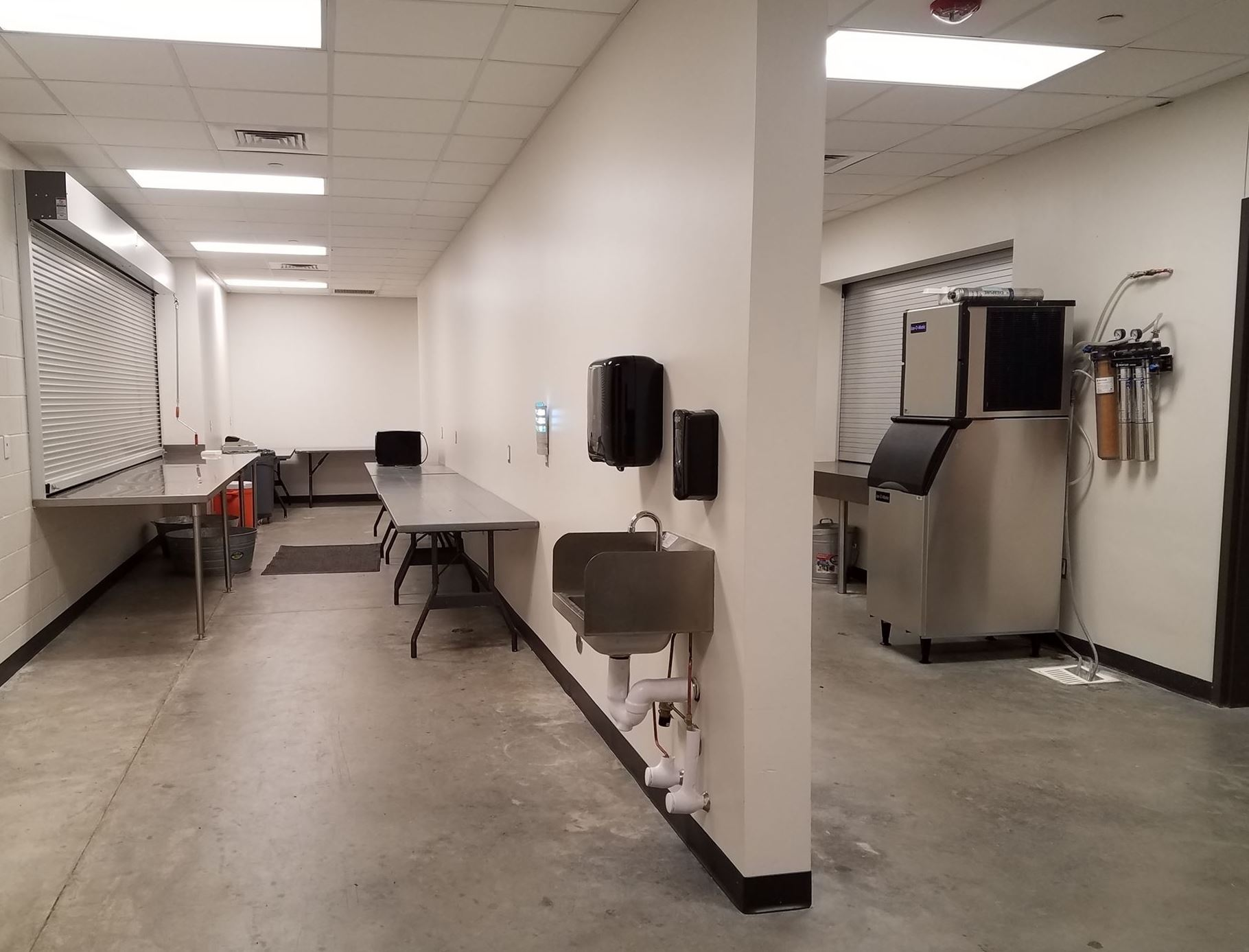 Indoor Catering Kitchen with ice machines and tables