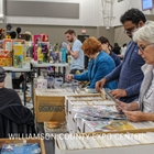 event guest browsing records at a vendor booth