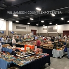 event attendees browsing vendor booths at the model train show