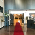 red carpet leading into the South Indoor Expo Hall entrance doors. Guest sign in area next to the door