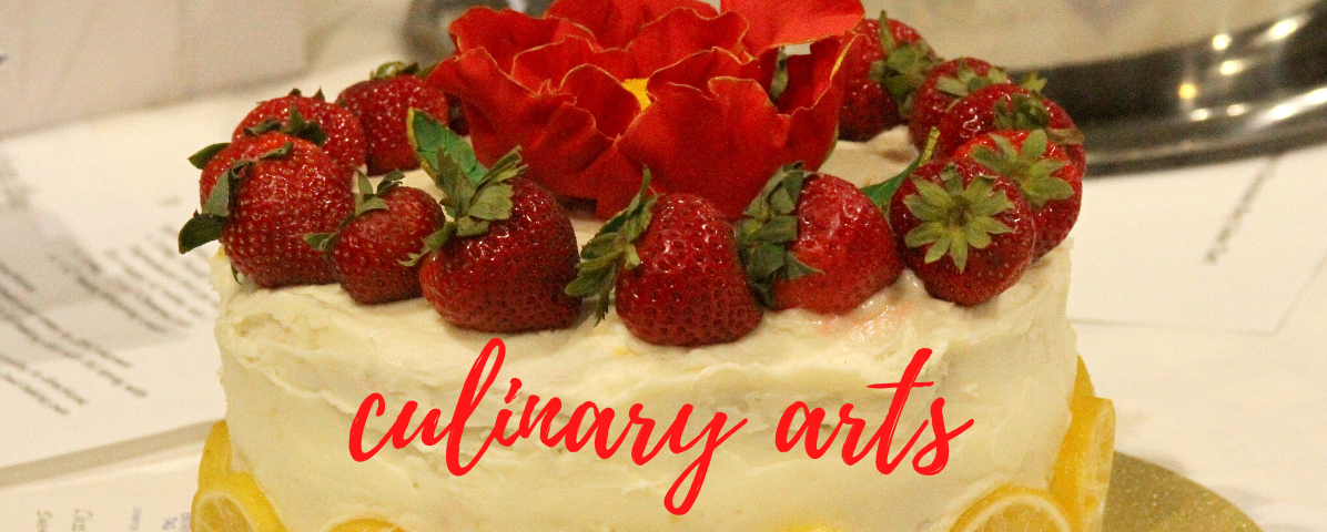 Cake decorated with strawberries and lemons