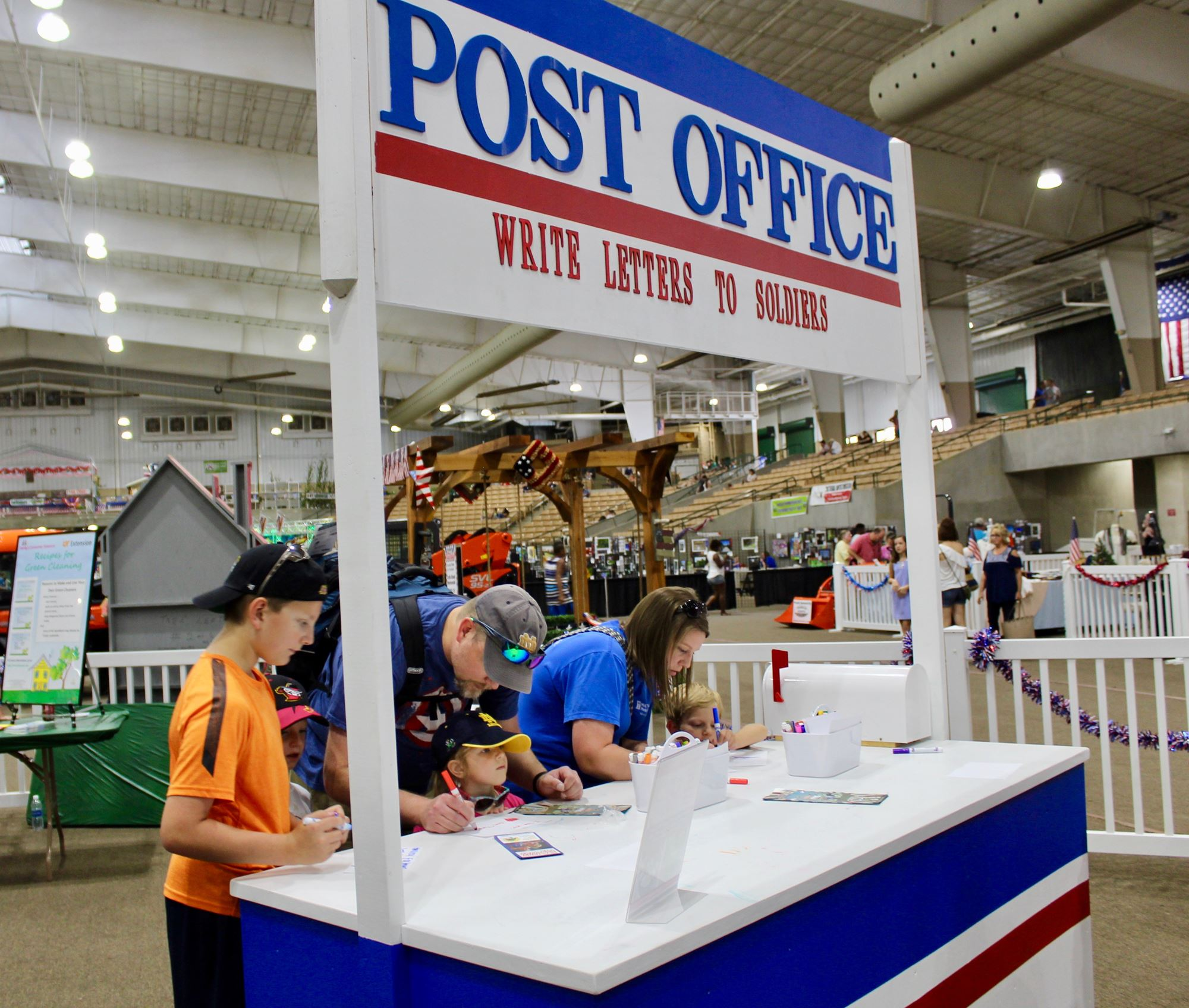 People writing letters to soldiers at the village post office