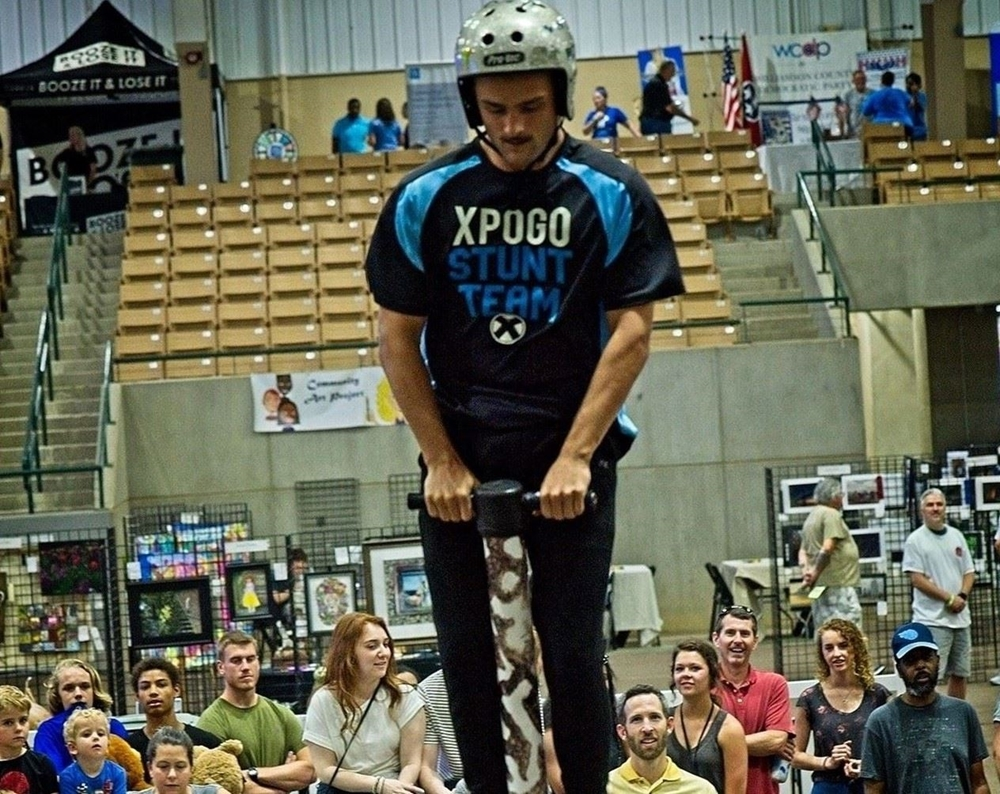 Xpogo team member jumping on a pogo stick