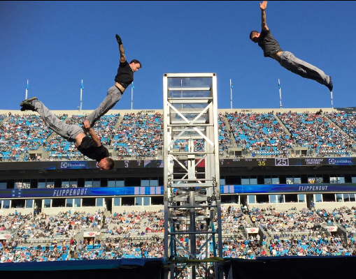 Extreme trampoline entertainers as they jump through the air.