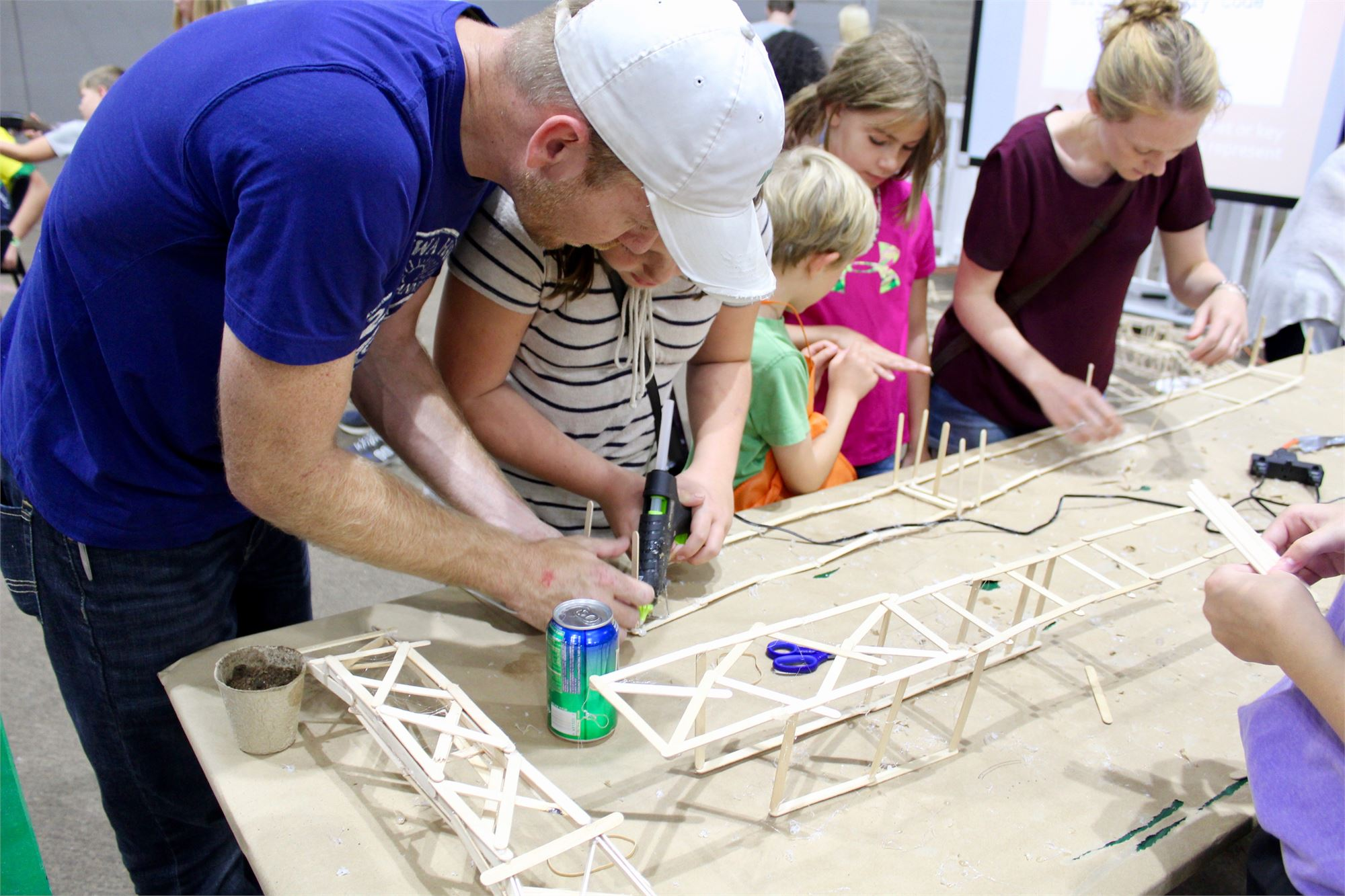 People building with popsicle sticks