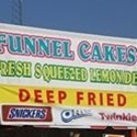 Banner that says Funnel Cakes, Fresh Squeezed Lemonade and Deep Fried desserts