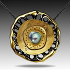 Black rhodium and solid 18k yellow gold pendant