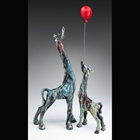 raku fired sculpture of two giraffes