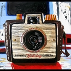Bold palette knife oil painting on canvas of a camera