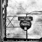 graphite on cradled clayboard of a coco cola sign