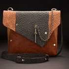 brown handbag made from genuine cow leather