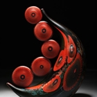 crimson glasswork shaped like a crescent moon