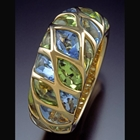 Hand cut Blue Topaz and Peridot in 18K gold ring