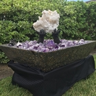 museum quality clear quartz center piece with a custom-made hands from cement with amethyst crystals and smoky quartz crystals in a hand made concrete bowl polished smooth with infused crystals and copper