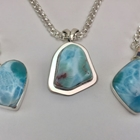 Different shaped pendants with modern clean lines. Sterling Silver accents the brilliant beauty and variety of the AAA grade natural Larimar gemstones.