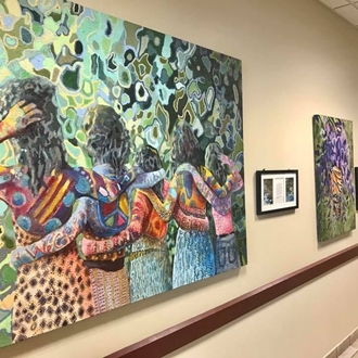 photo of artwork hung on walls in mall