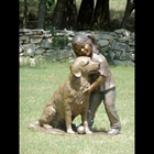 child holding dog sculpture